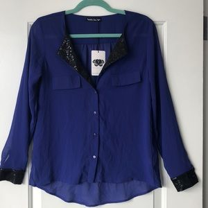 Purple and black Double Zero blouse.